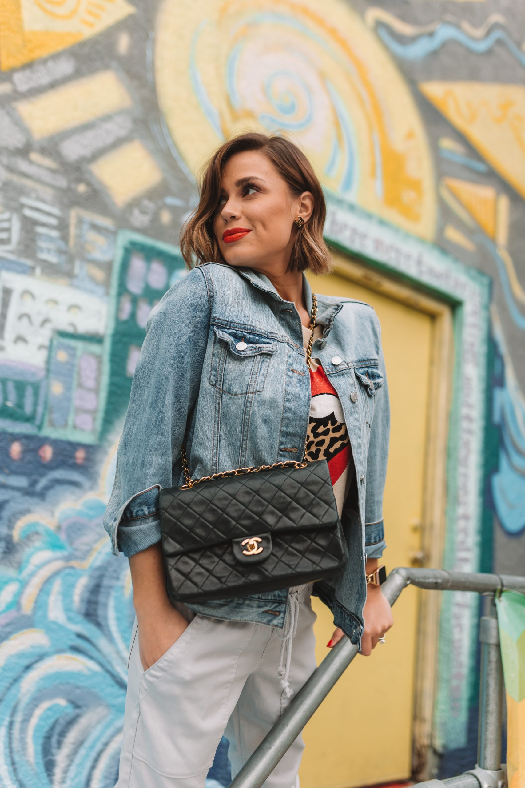 Elly Brown wears a vintage Chanel bag with matching vintage Chanel earrings