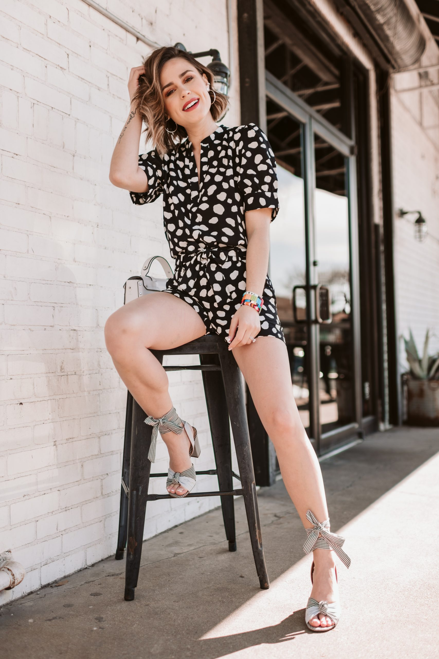 Houston fashion blogger Elly Brown wears a matching spot set from Ann Taylor with Gingham shoes