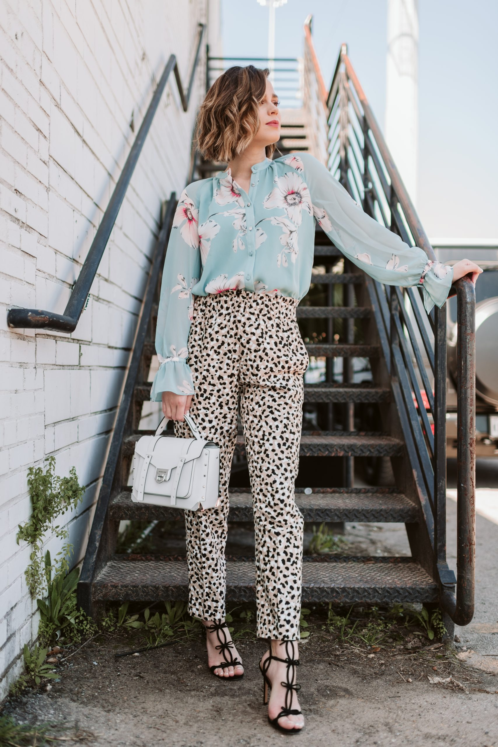 Houston fashion blogger Elly Brown wears a floral top with leopard pants from Ann Taylor