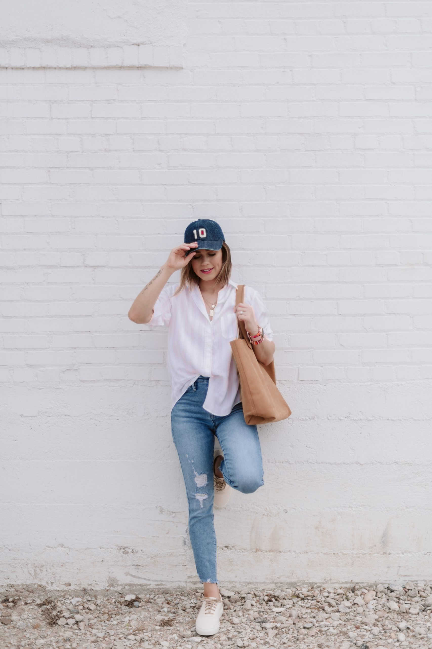 Houston fashion blogger Elly Brown wears a Grayson button up top with J.Crew denim