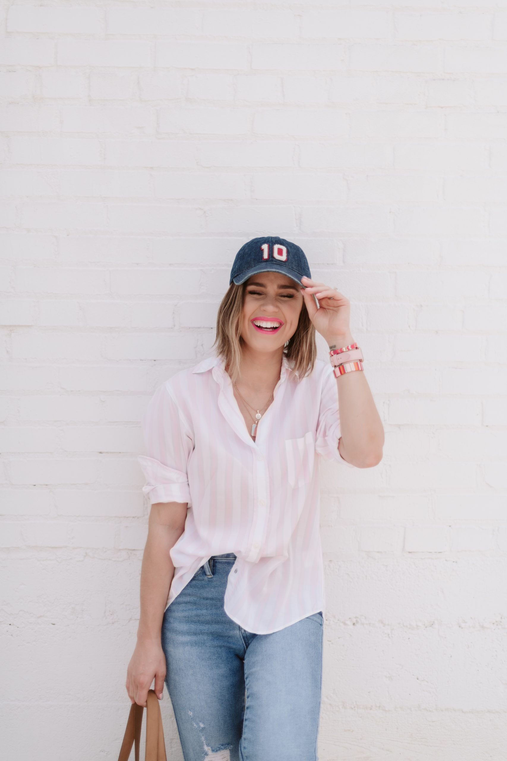 Houston fashion blogger Elly Brown wears a Grayson button up top with a denim hat