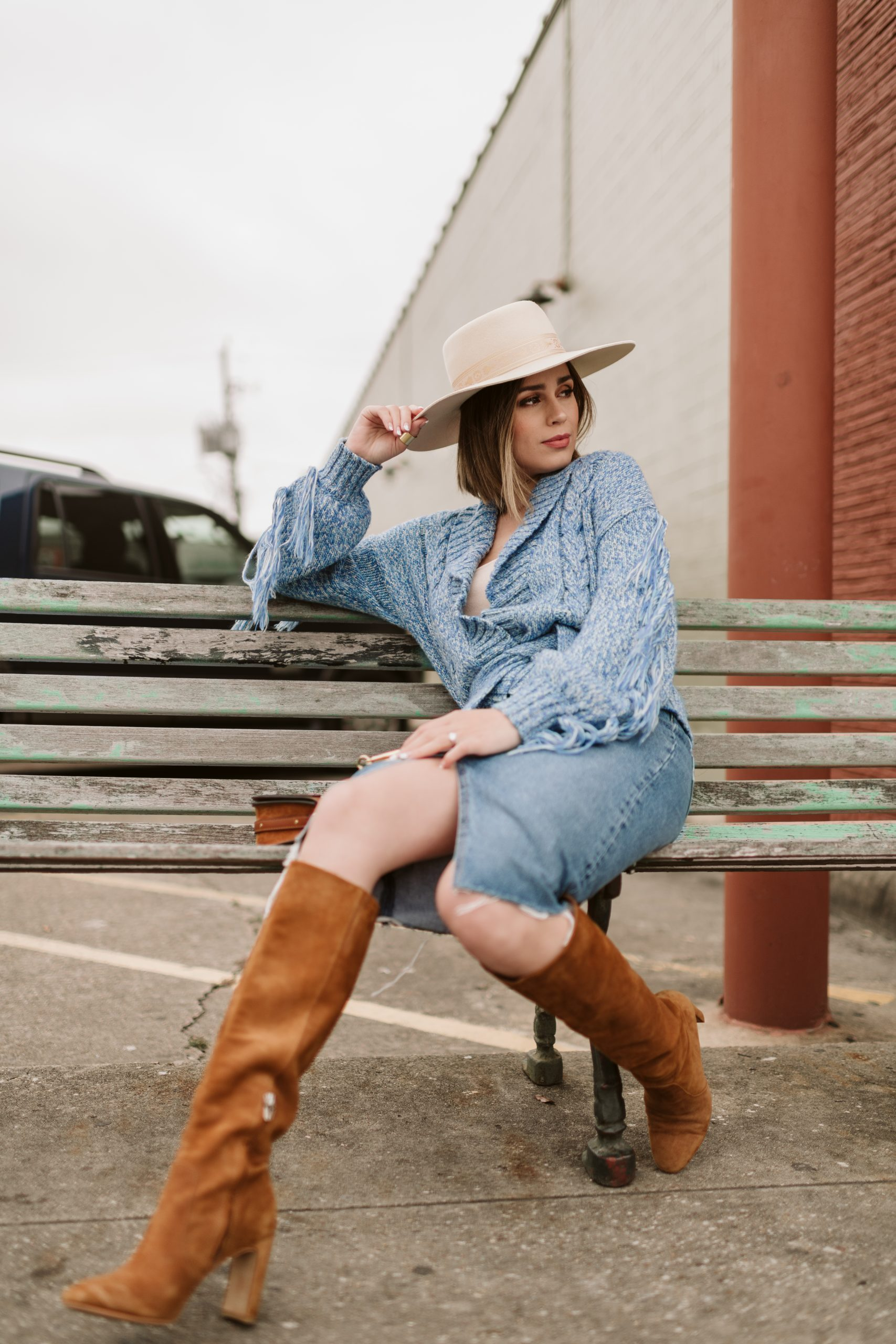 Houston fashion blogger Elly Brown wears a Lack of color felt hat with a fringe sweater from Revolve