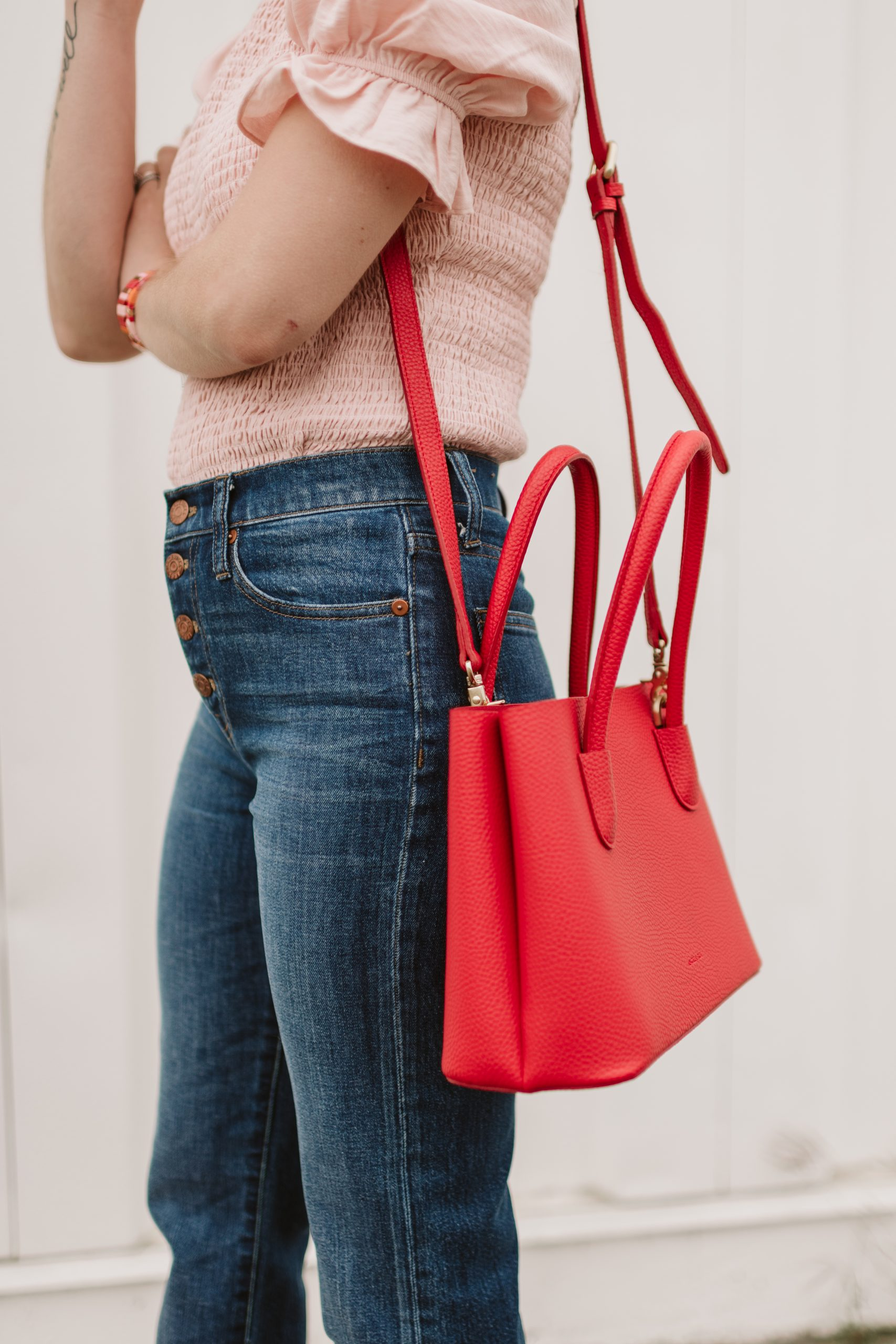 Houston fashion blogger Elly Brown wears a Angela Roi mini tote