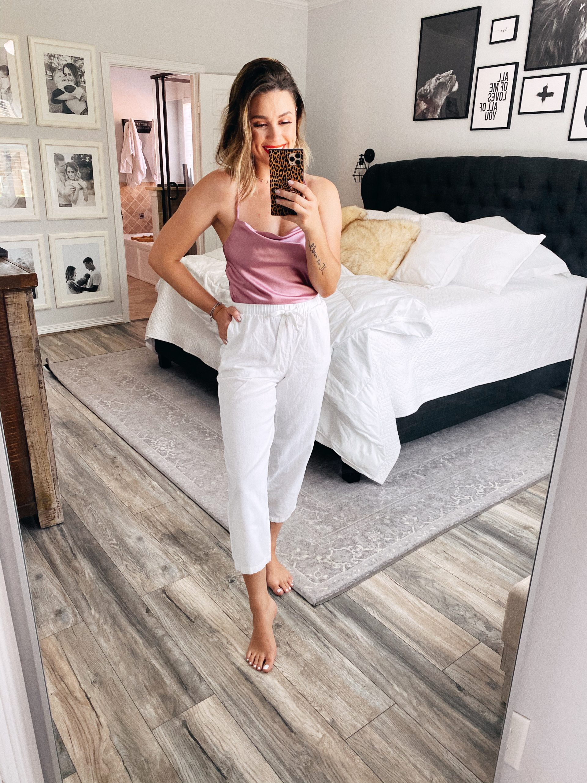 Houston blogger Elly Brown wears a silk cami and linen pants for At Home Date Night Outfits