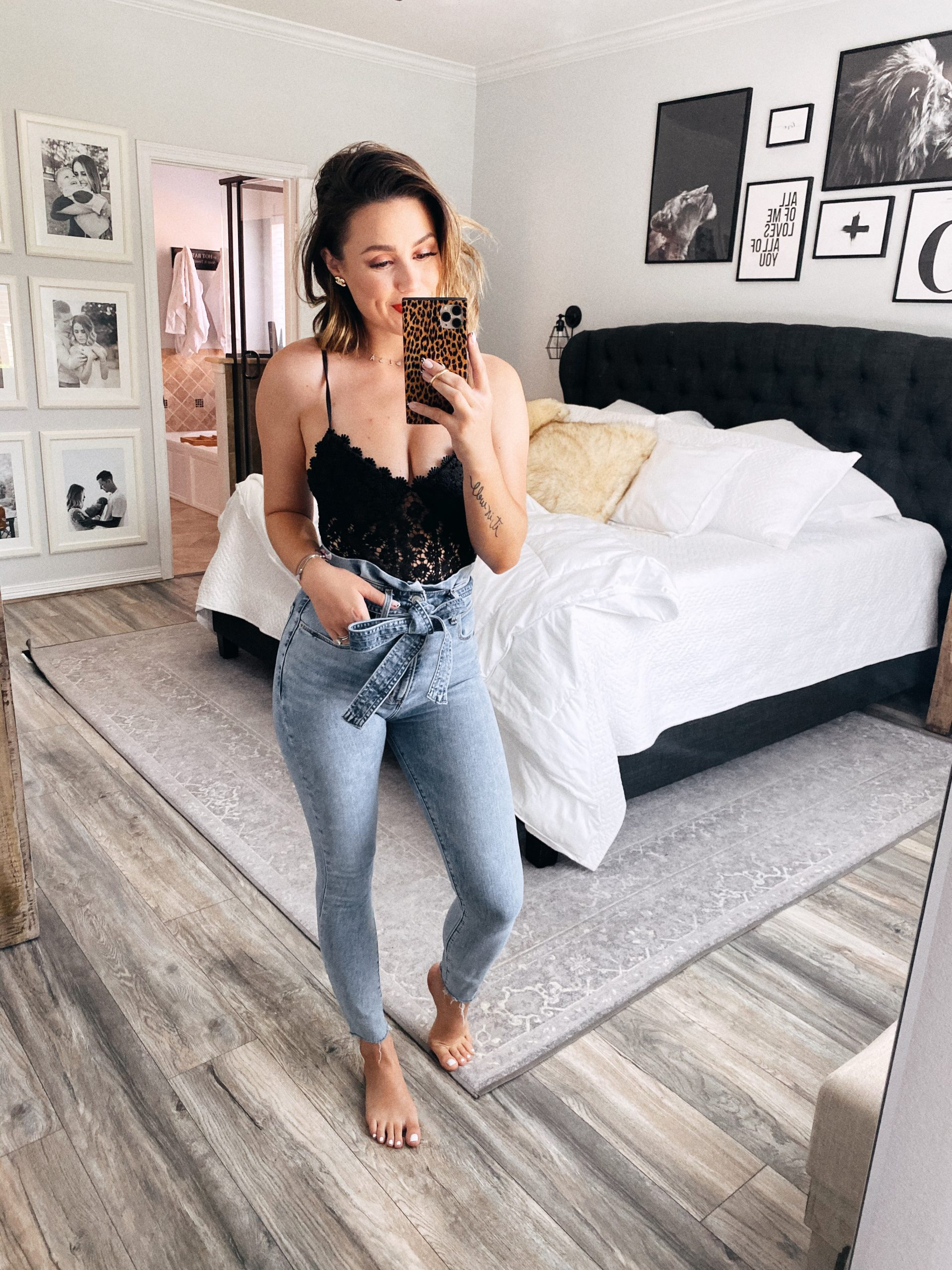 Houston blogger Elly Brown wears lace bodysuit and high waisted denim for At Home Date Night Outfits