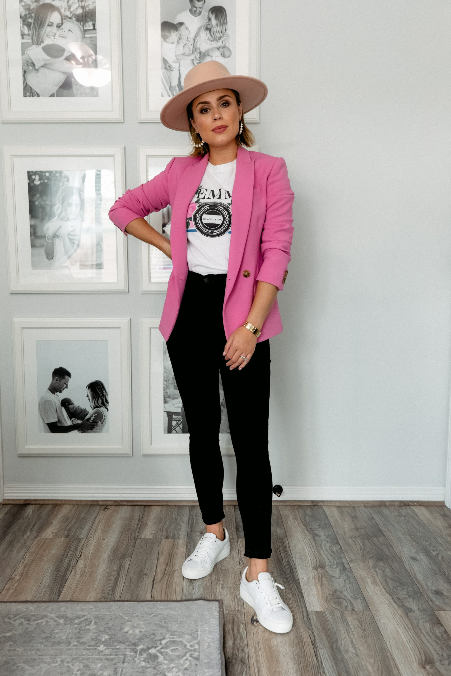 Houston blogger Elly Brown wear black high waisted denim with a pink blazer