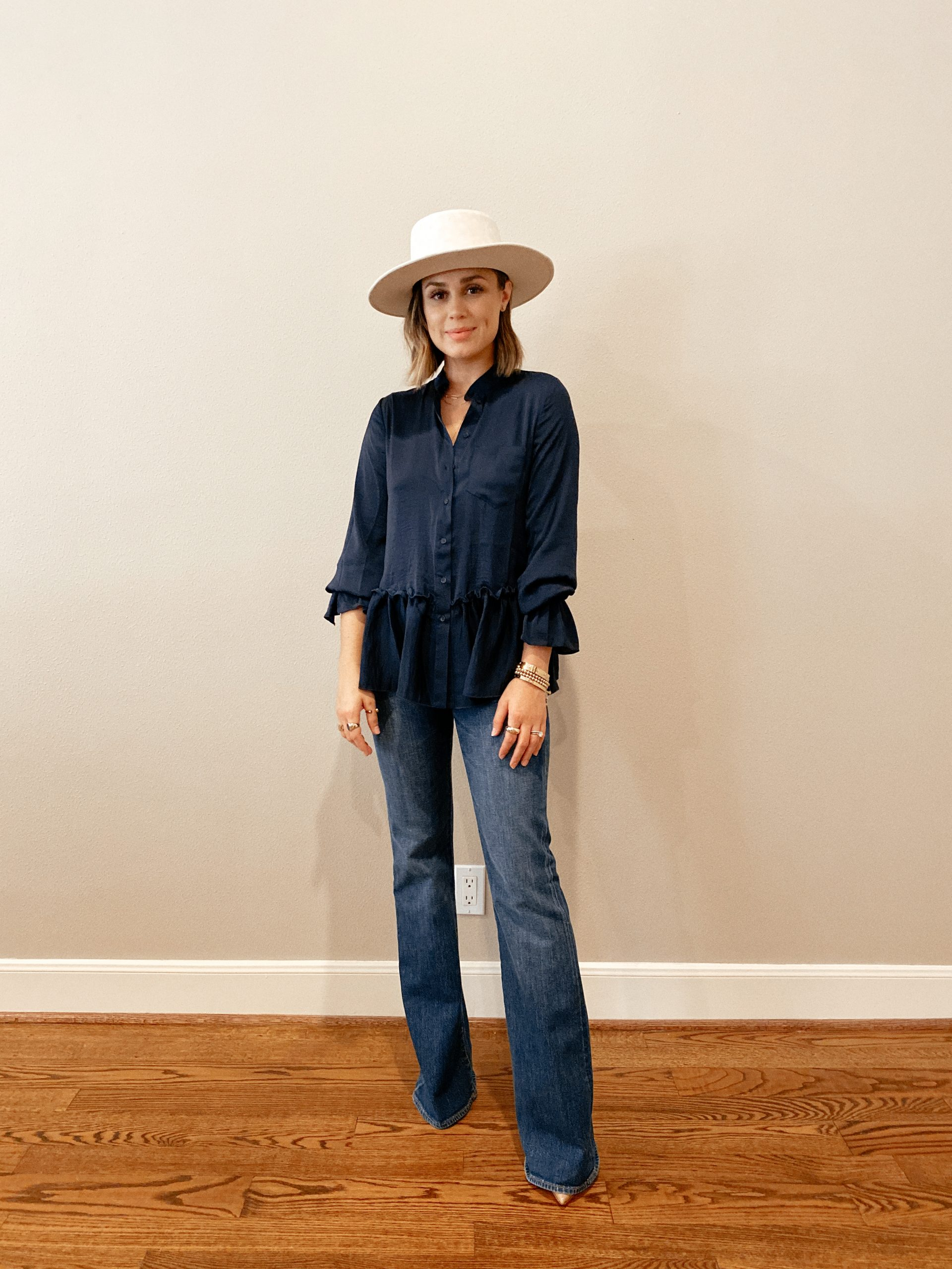 Elly Brown wears high-waisted flared denim from J.Crew