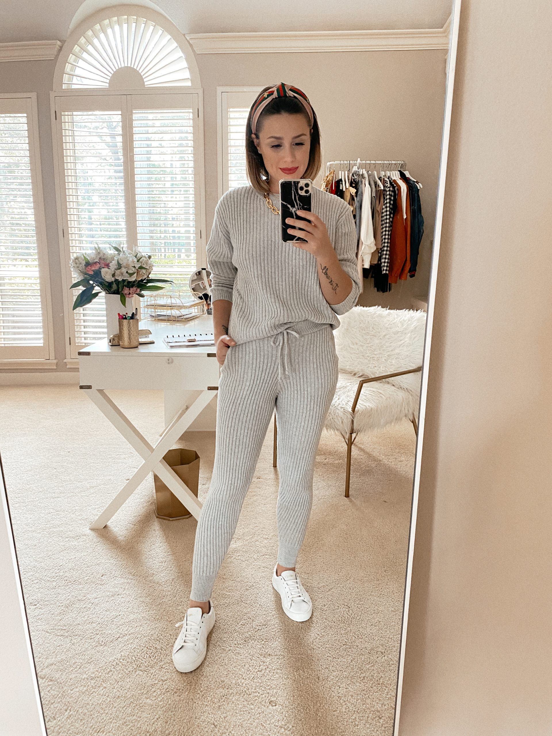 Elly Brown wears a cute and comfy grey loungewear set from Revolve