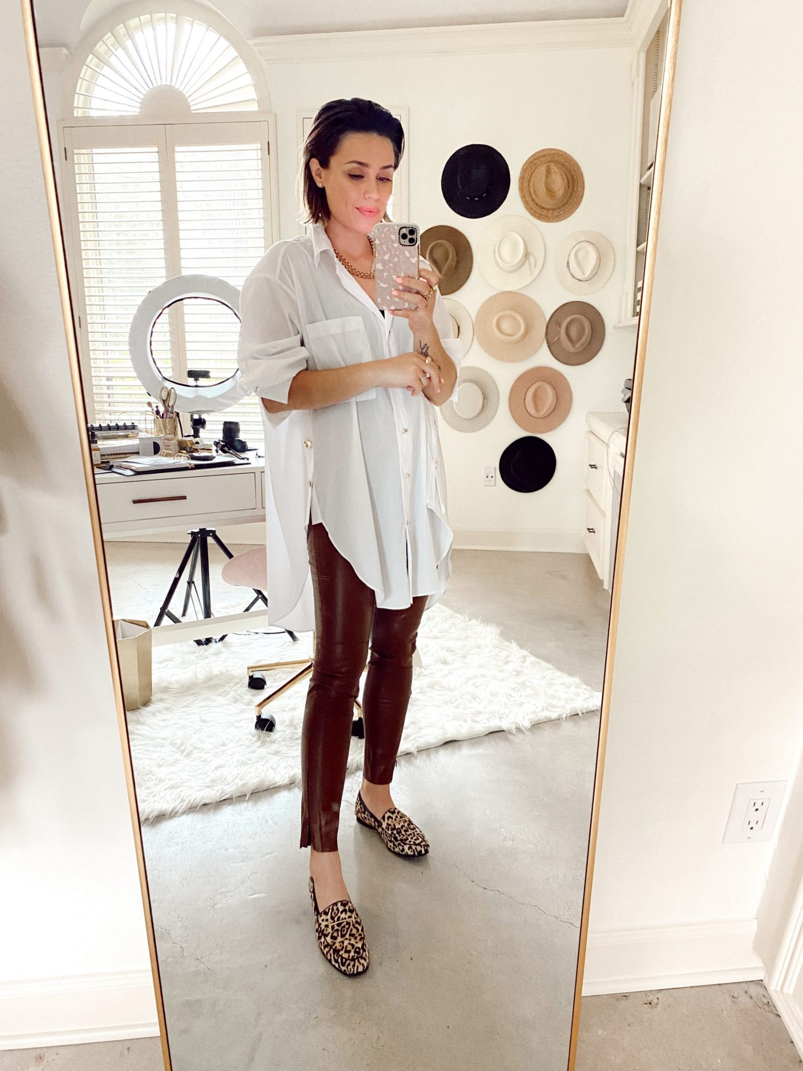 Elly Brown wears a Zara leather pants with an oversized white top and leopard loafers