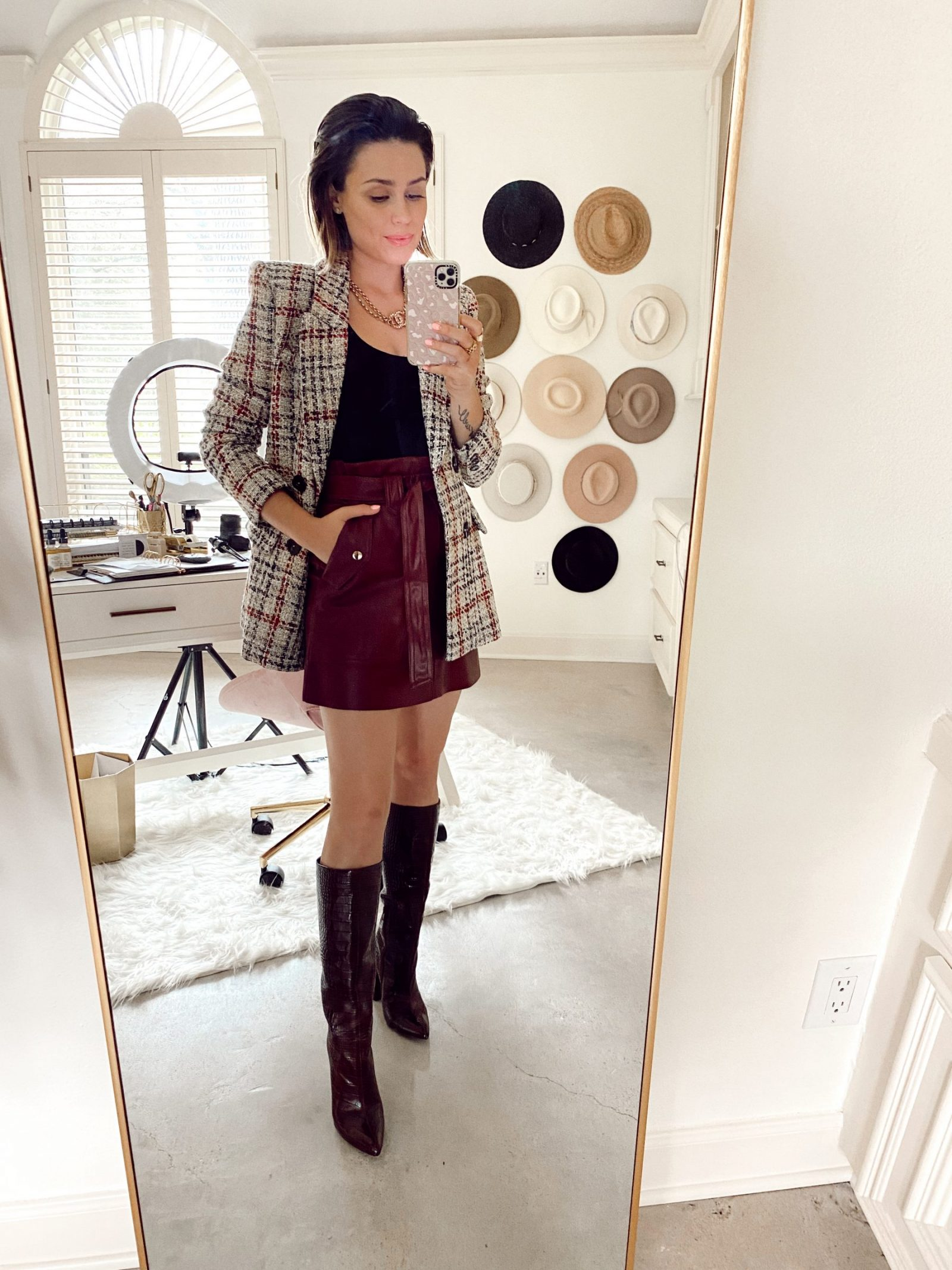Elly Brown wears Zara plaid blazer paired with Faux skirt and knee high boots