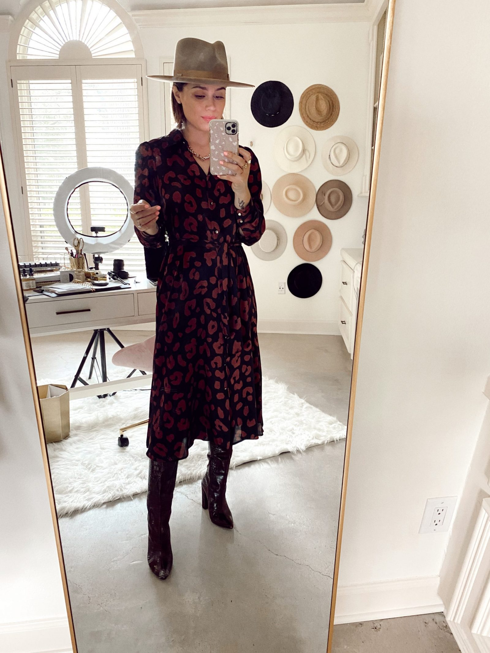 Elly Brown wears a Zara printed shirt dress with knee high boots and a Gigi Pip hat