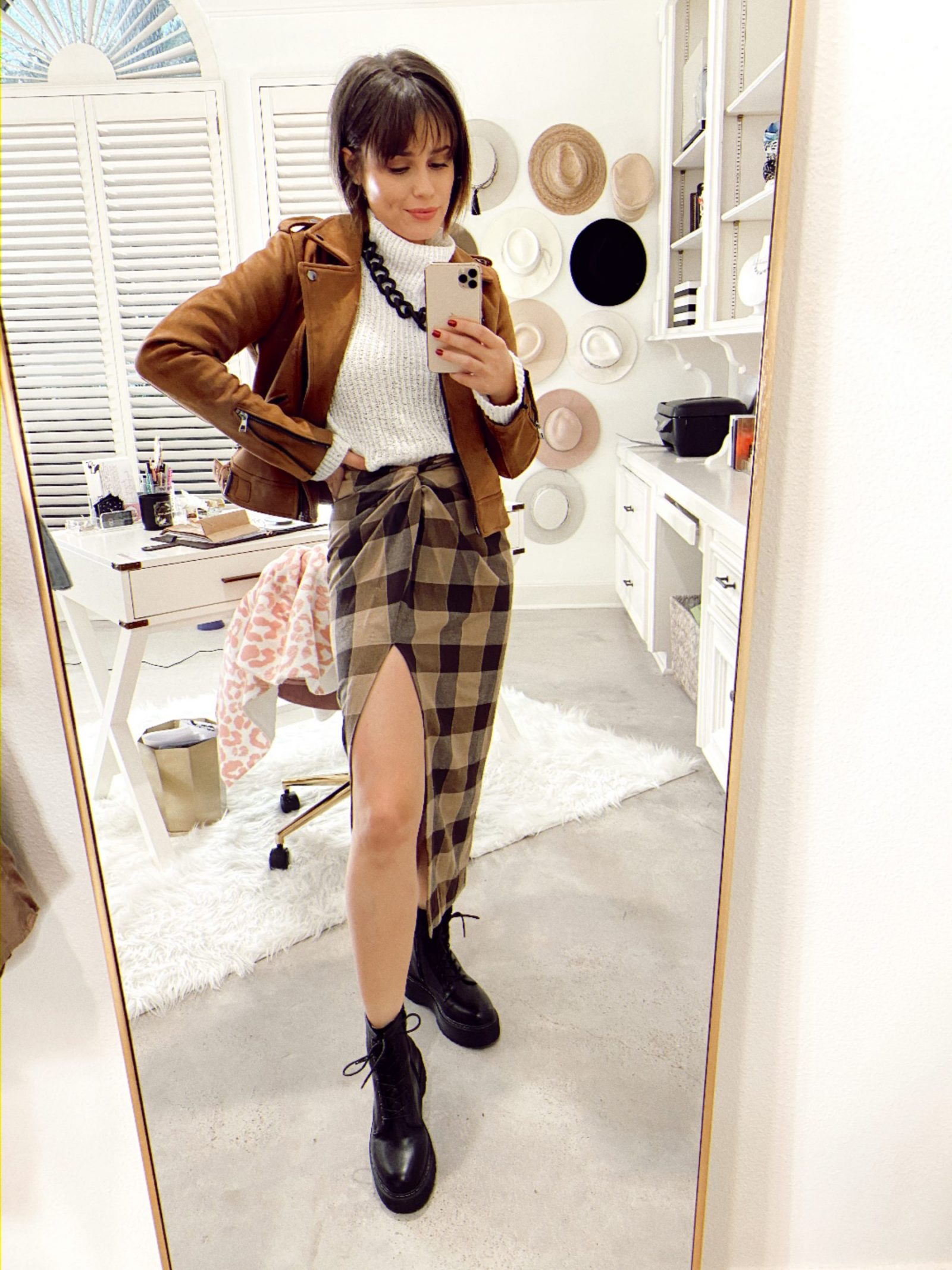 Elly Brown wears a plaid slit skirt from zara with combat boots