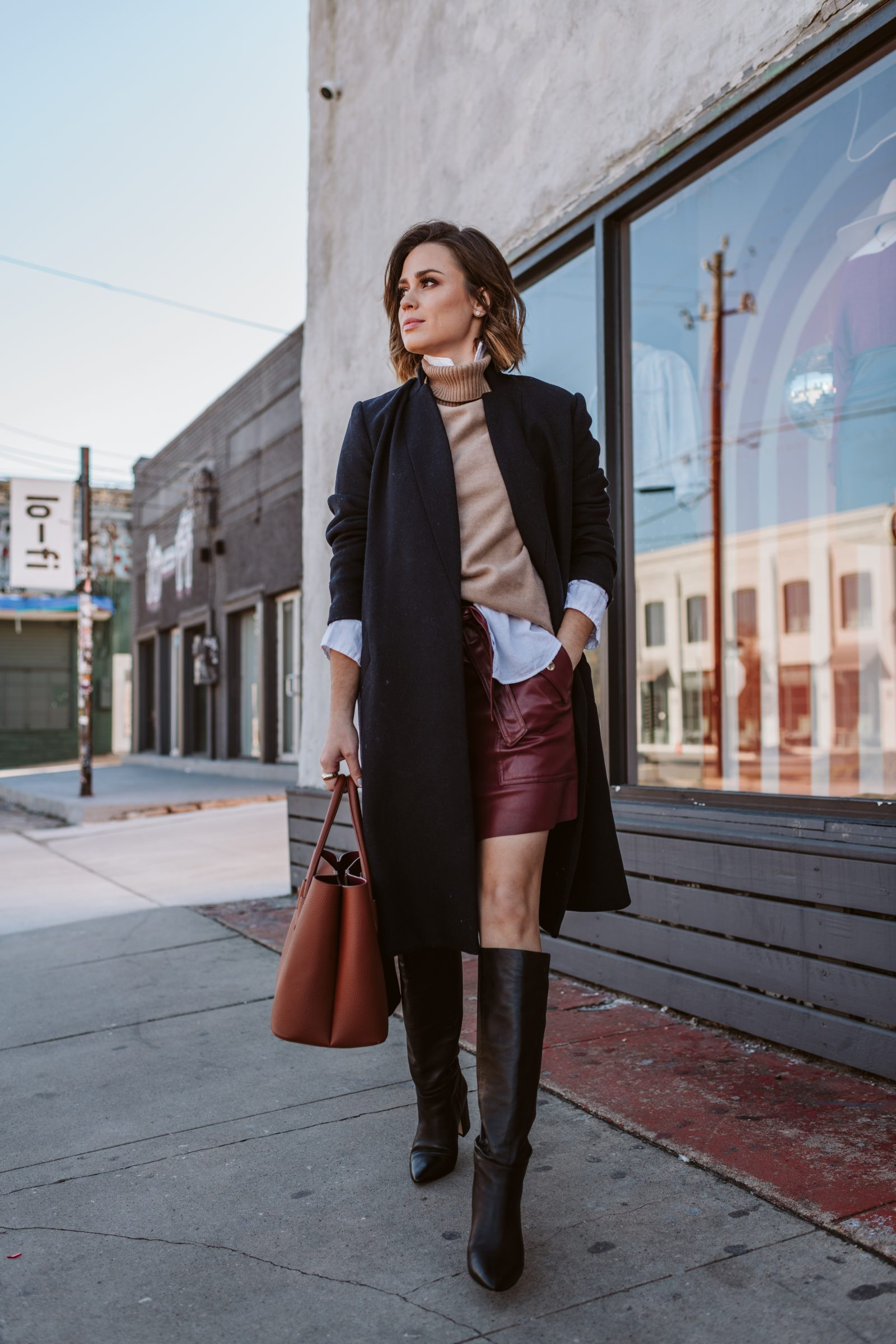 Elly Brown wears a layered winter outfit look. knee high outfit ideas / wool coat outfit ideas.