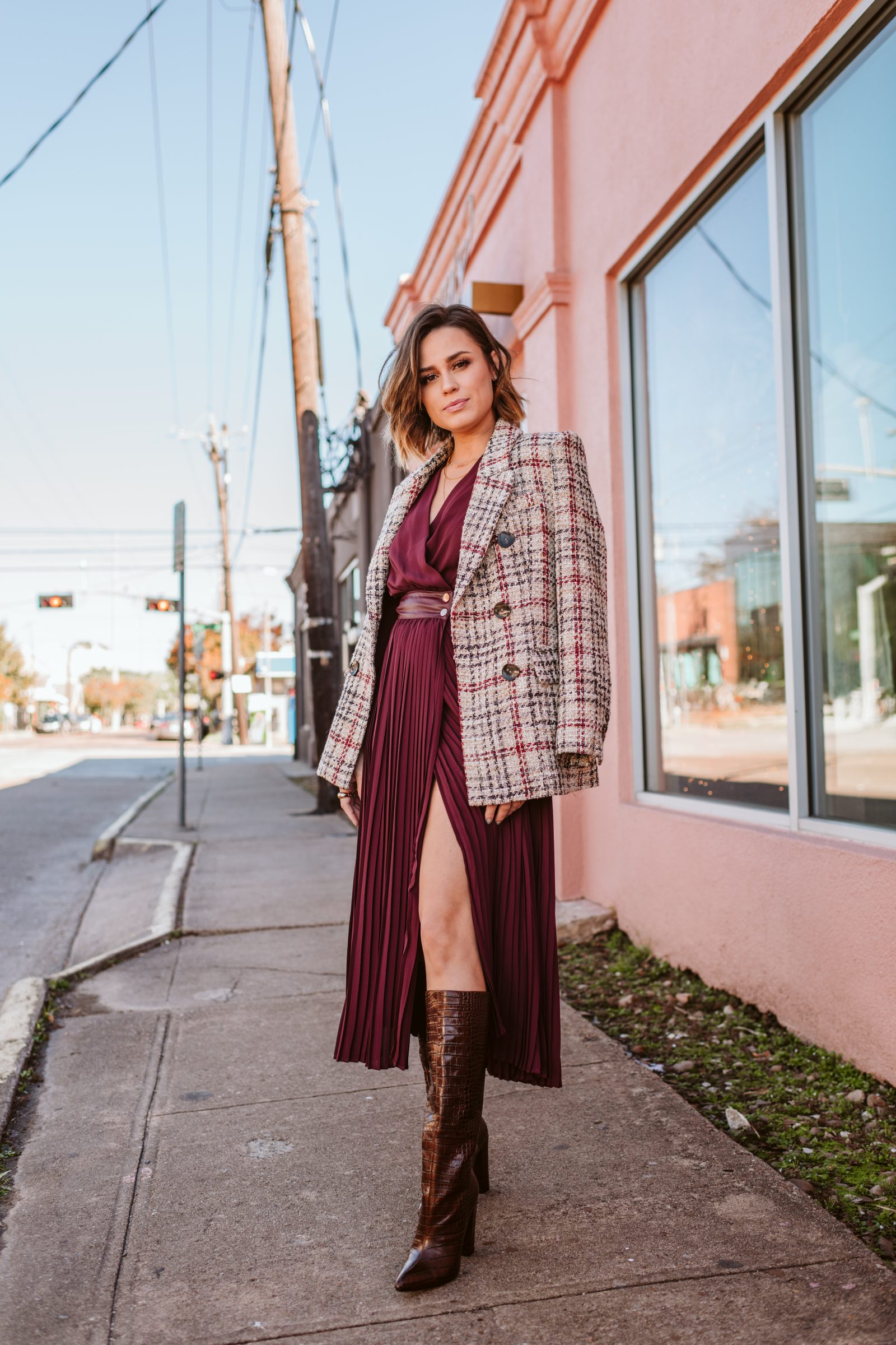 Elly Brown wears a zara dress and tweed blazer with knee high croc boots for a chic winter look