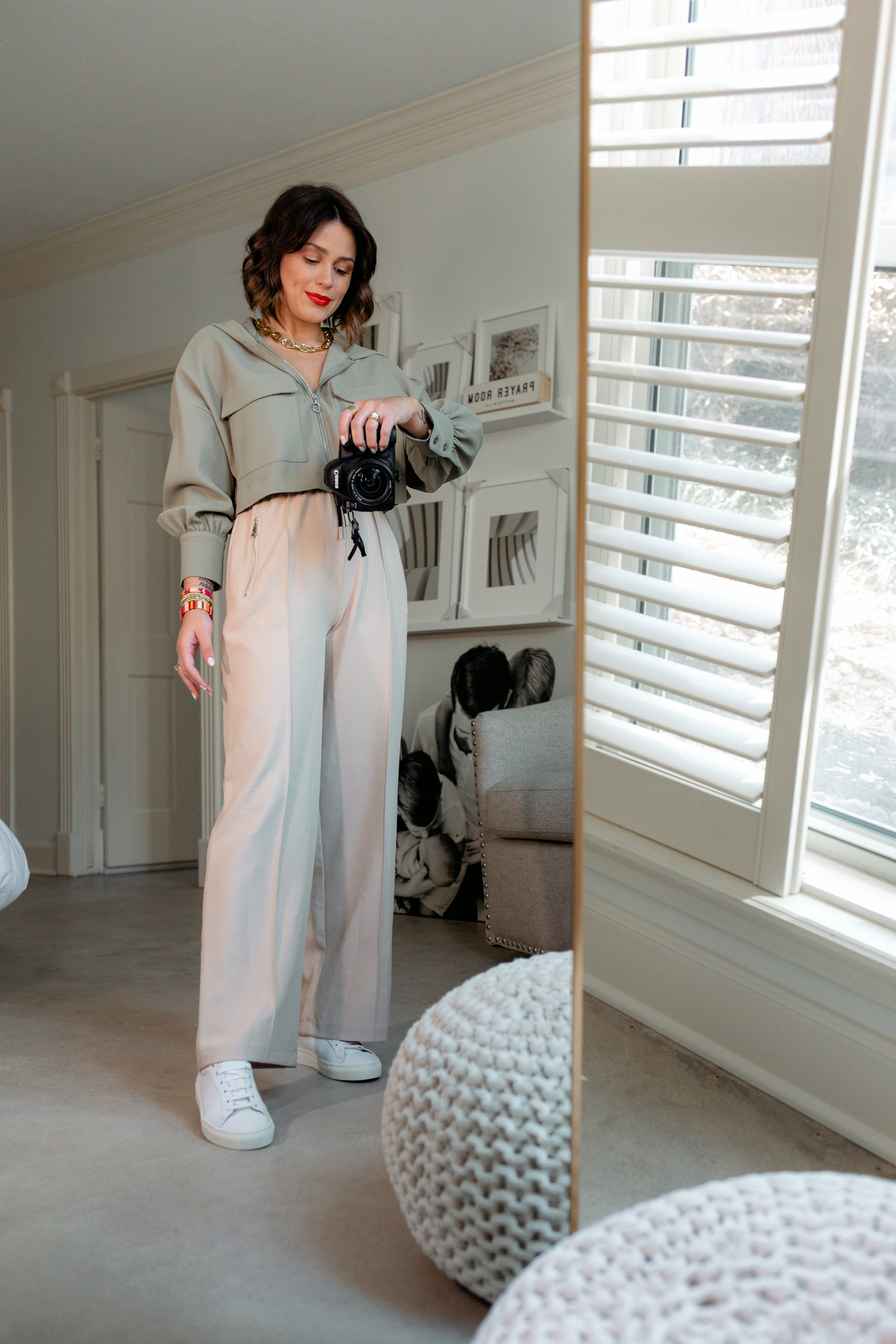Elly brown wears a safari inspired outfit trousers with a crop jacket and white sneakers