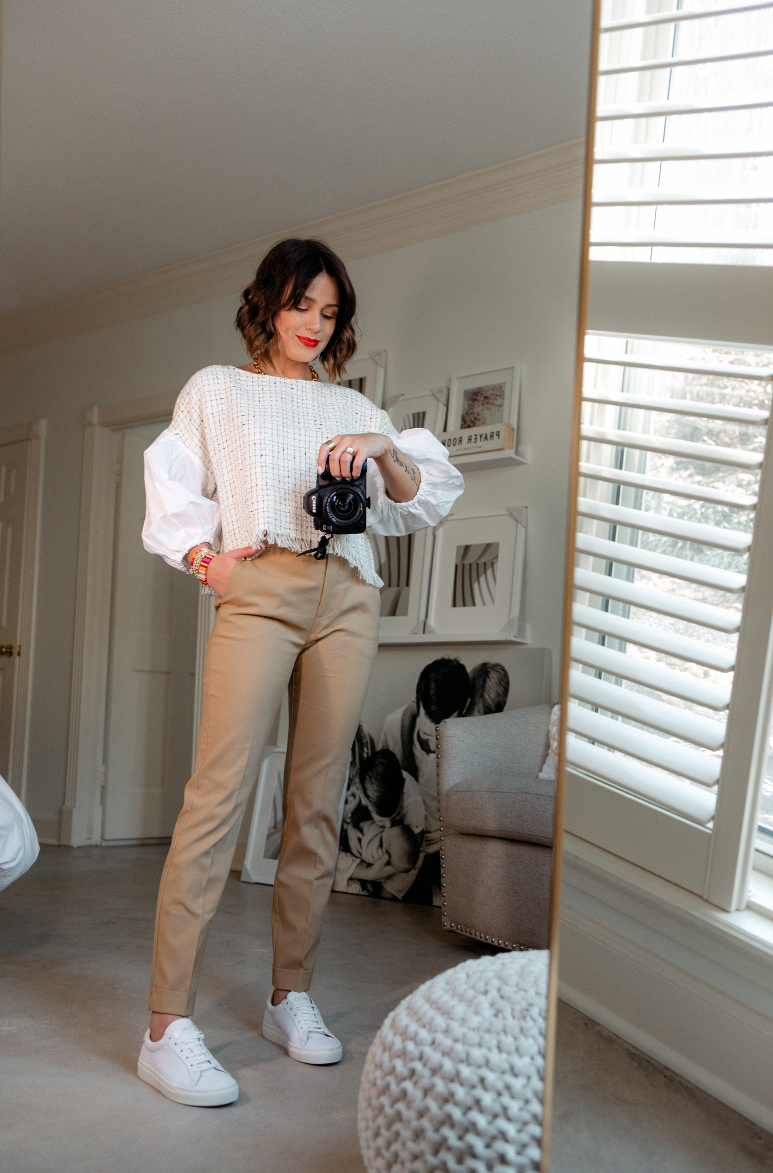 Elly Brown wears a ballon sleeve crop top with khakis and white sneakers from Zara