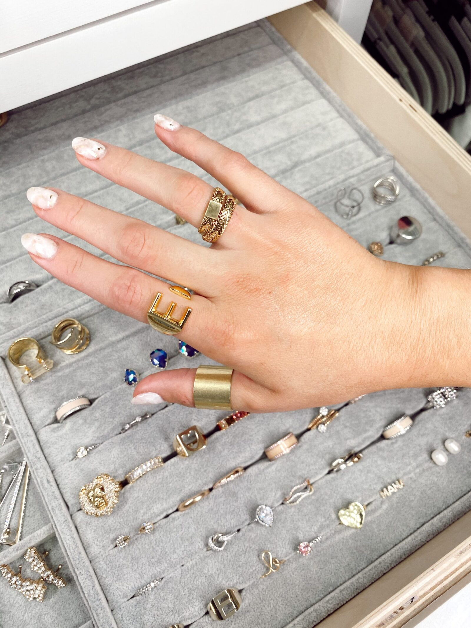 Wanting to elevate your look but not sure how? Houston fashion blogger Elly Brown rounds up her favorite everyday gold rings you will love.