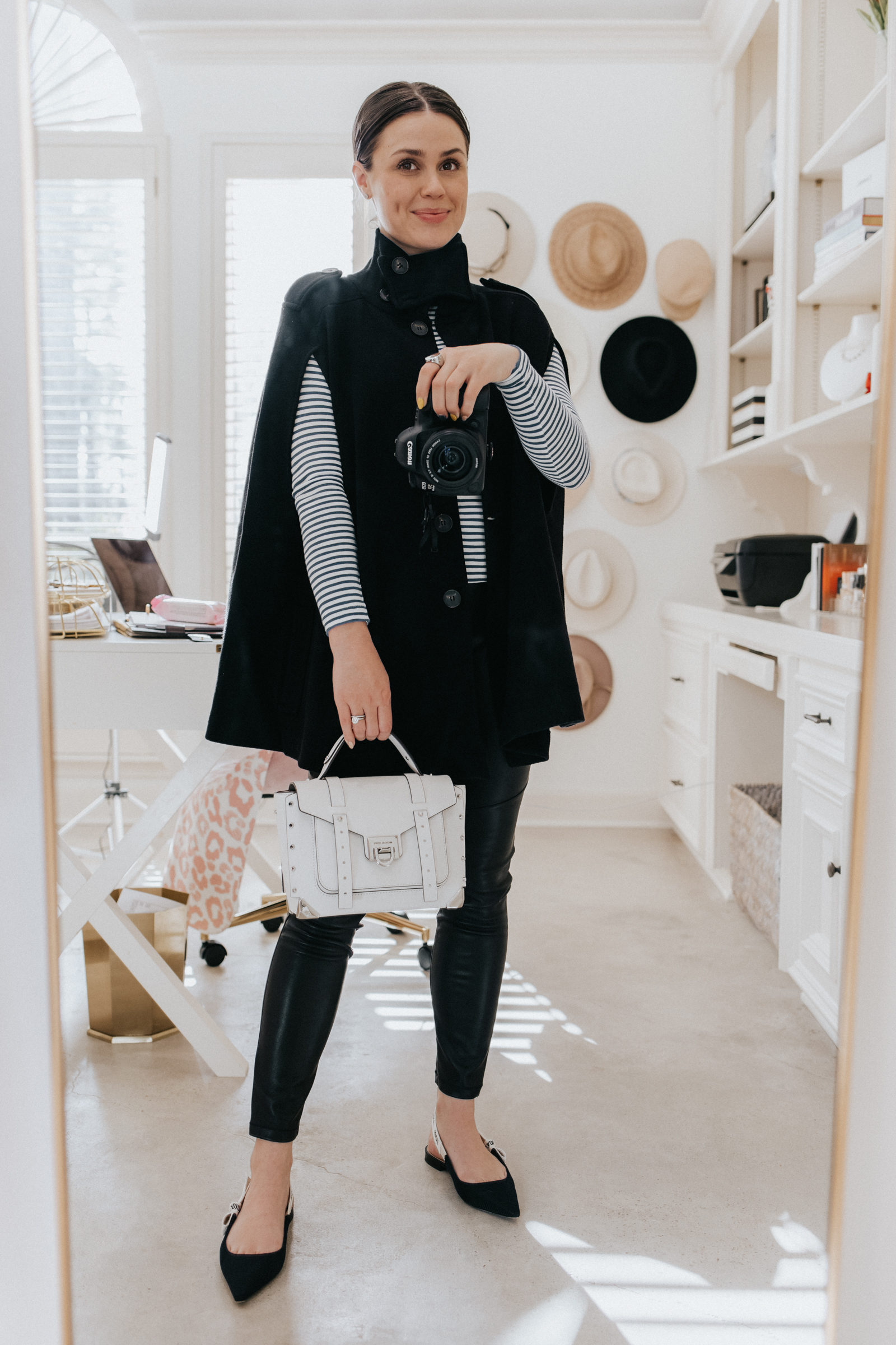 elly brown styles a winter cape coat from zara with faux leather leggings and a striped long sleeve