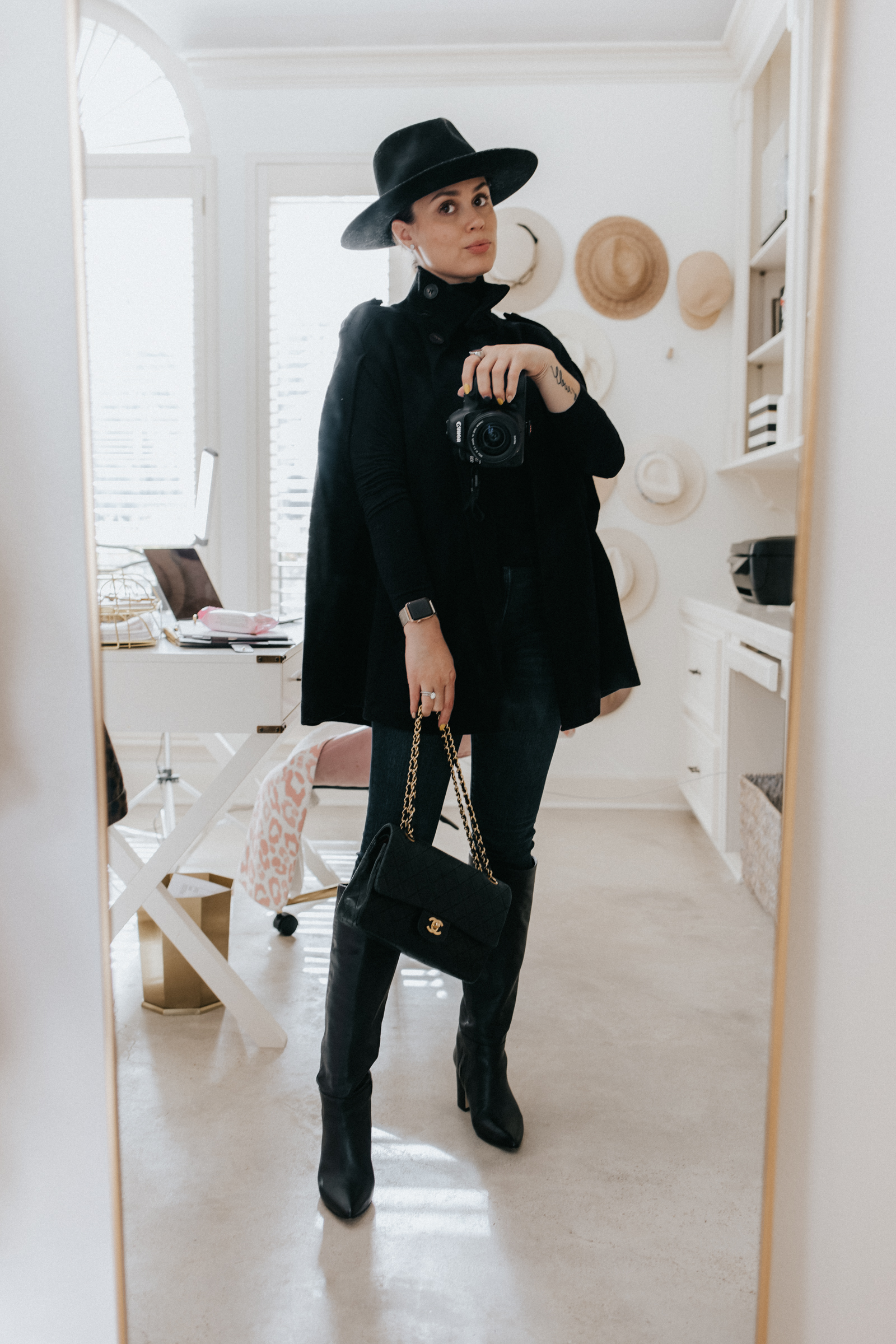 elly brown styles a winter cape coat from zara with knee high boots and a turtle neck