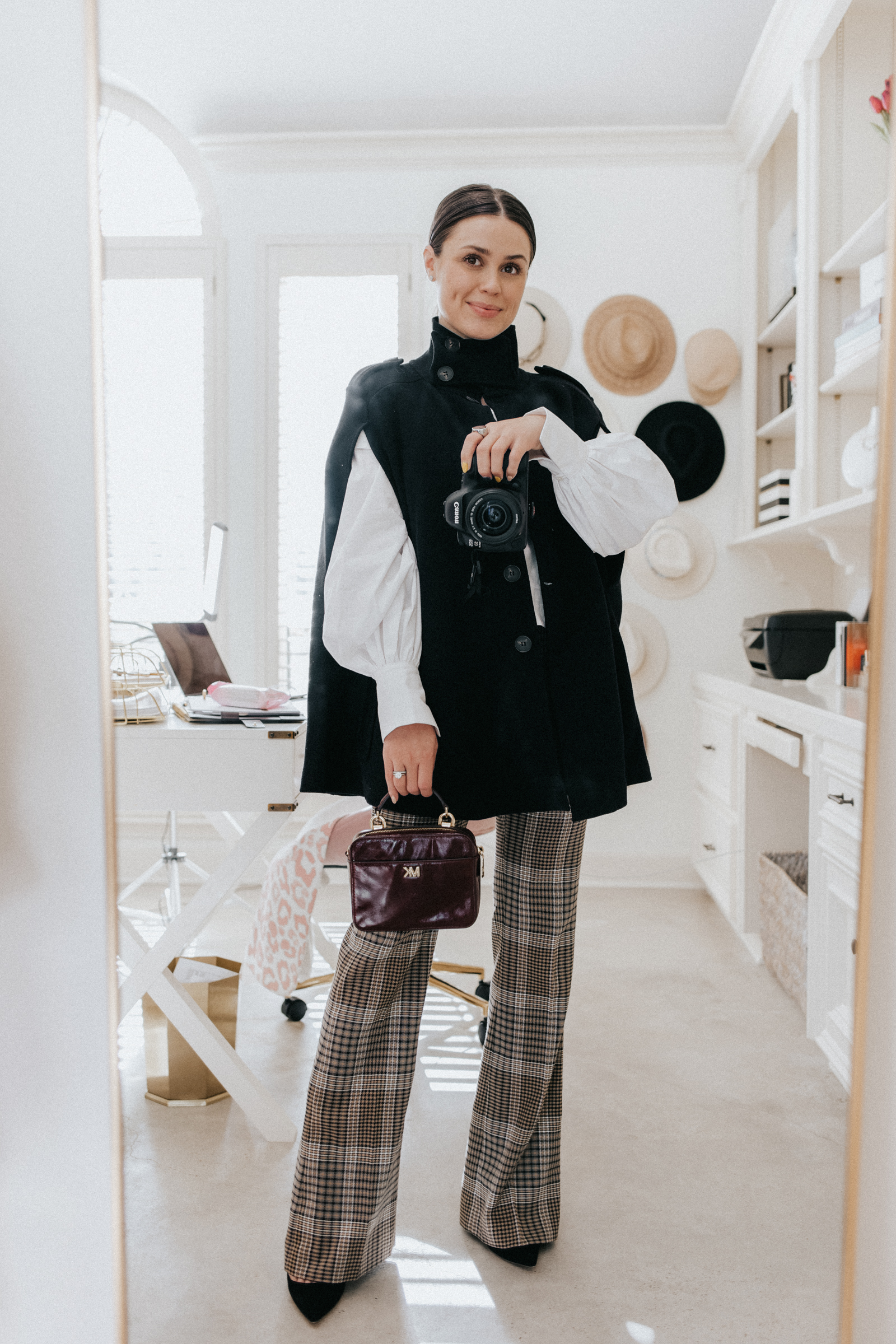 elly brown styles a winter cape coat from Zara with plaid flared pants and a white blouse