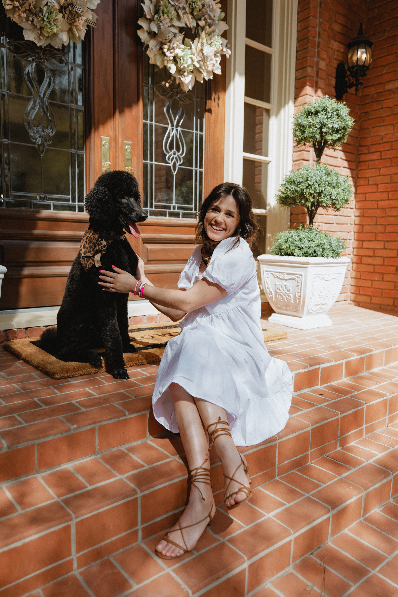 Elly Brown shares her front porch decor for Spring with her standard poodle