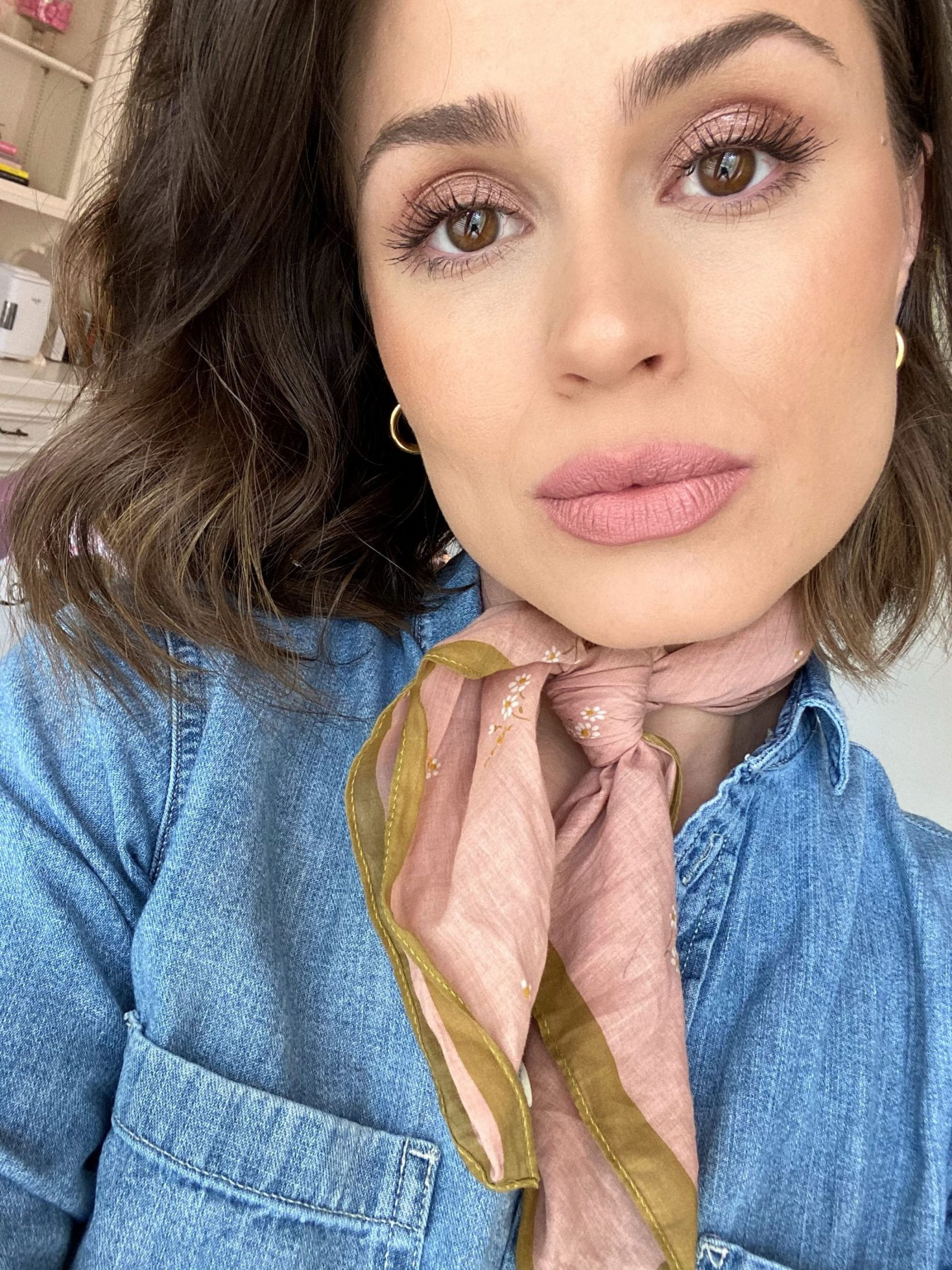 Elly Brown wears Modesty Nude lipstick by M.A.C