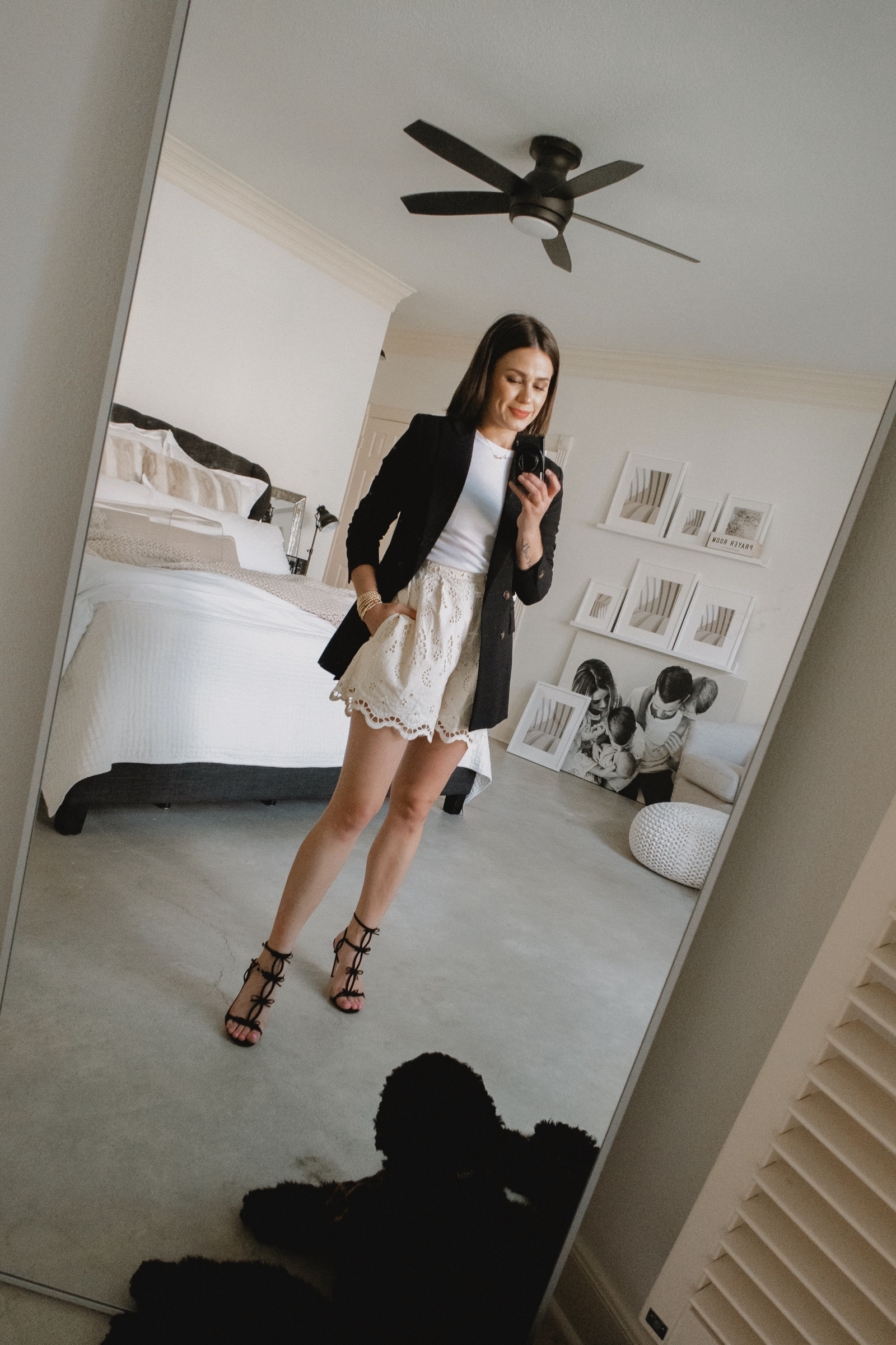 Elly brown pairs a blazer and shorts for a feminine look and bow sandals