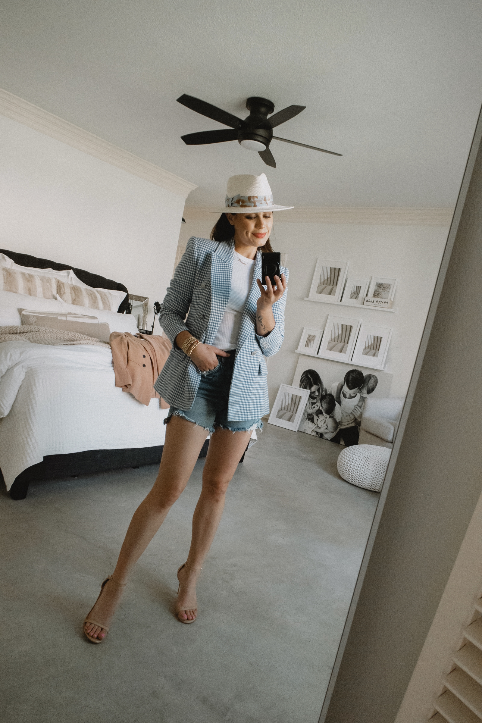 Elly Brown styles a blue gingham blazer from Zara with denim shorts and nude heels for a date night look