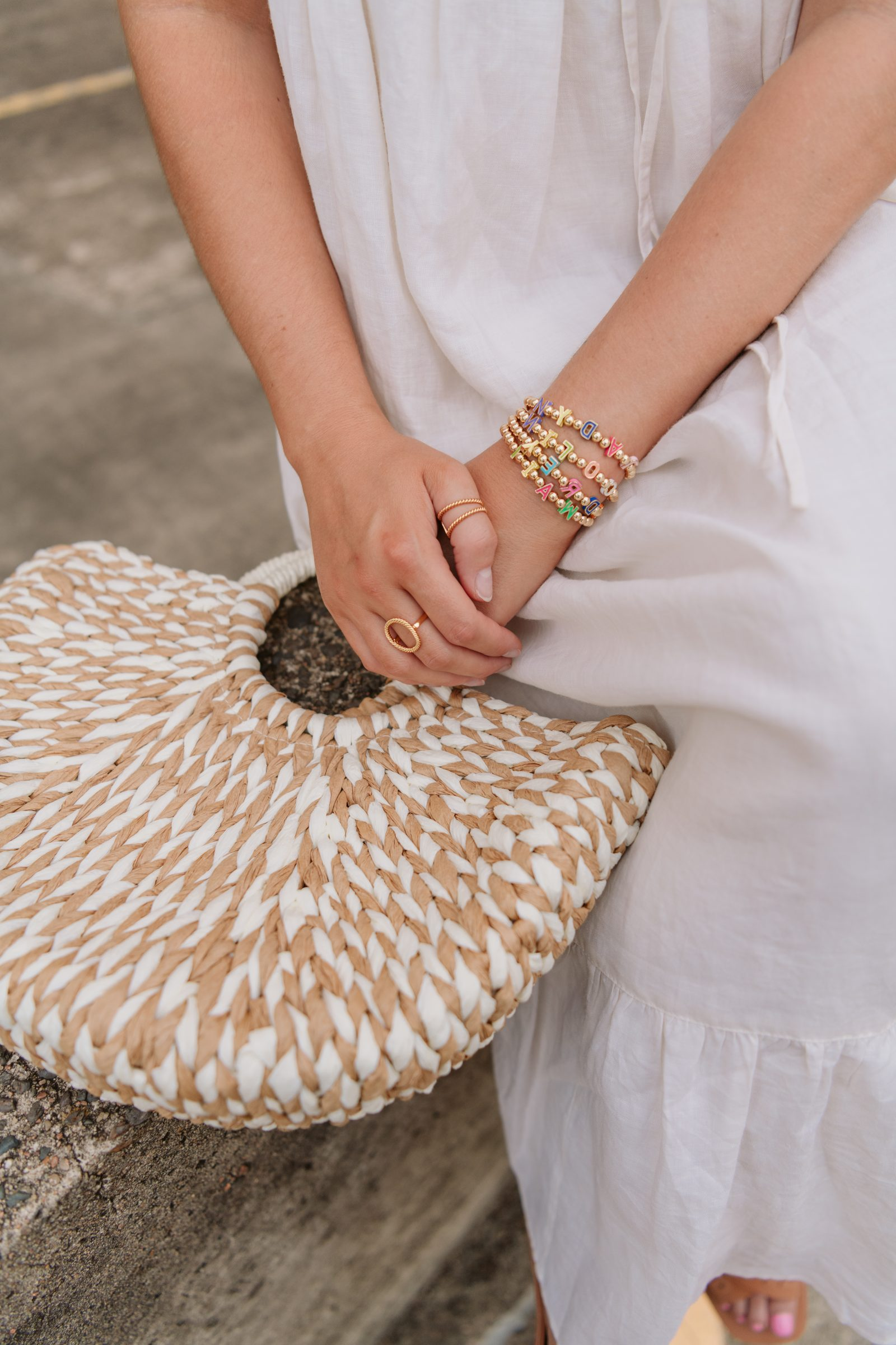 Houston Fashion Blogger Elly Brown wears a linen Summer dress with a straw bag for summer