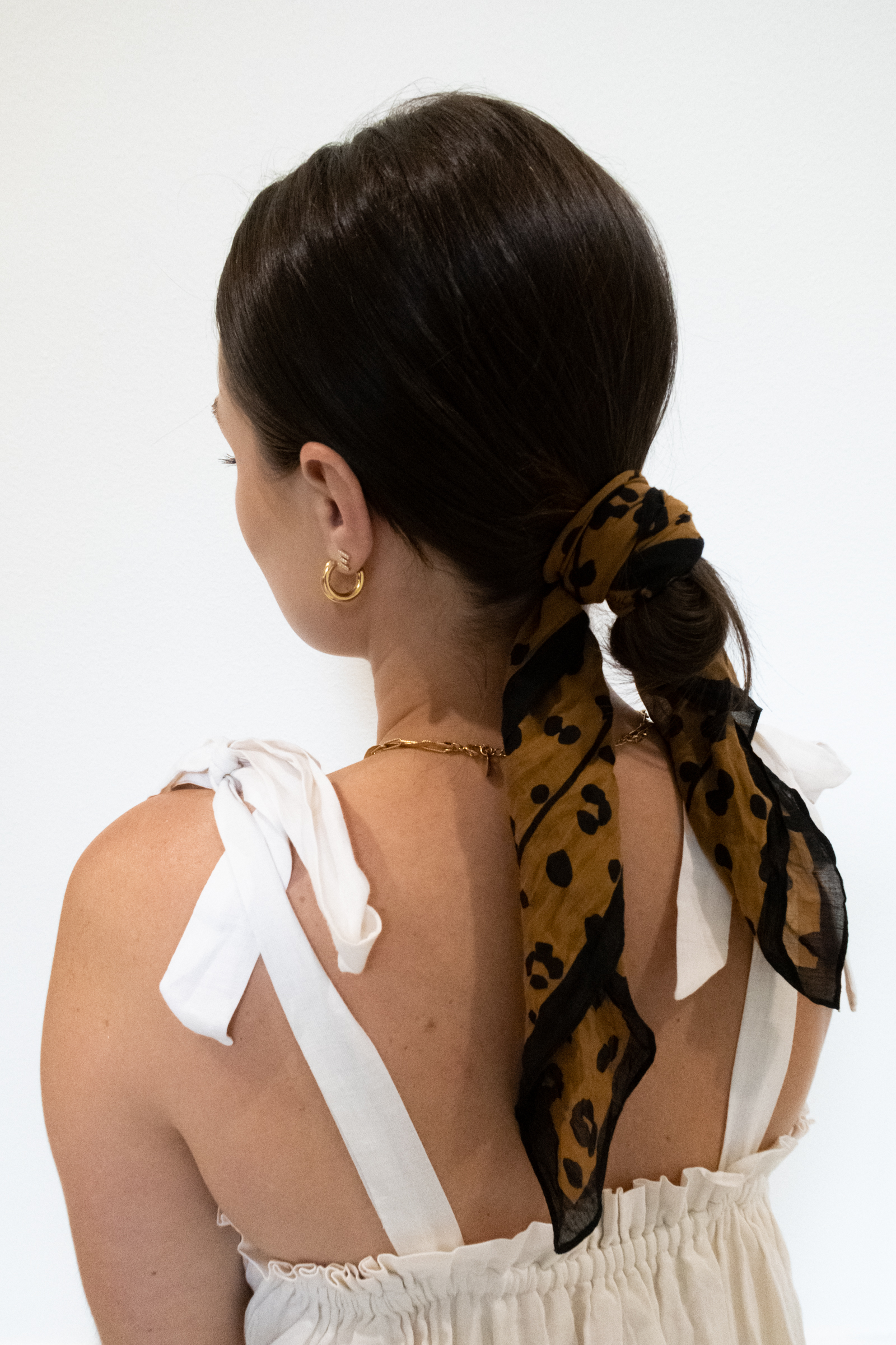 Summer Hairstyles for Short Hair: Elly Brown shares how to tie a head scarf for a summer hair-do!