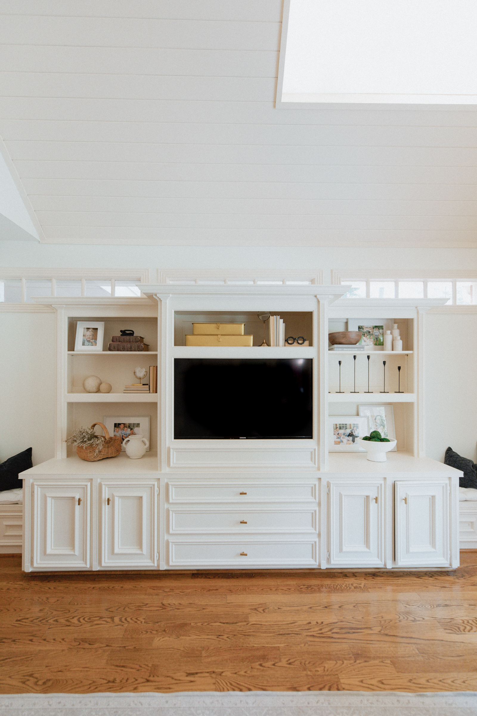Picture of book shelf with built in TV part living room decor
